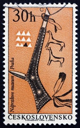 czechoslovakia: CZECHOSLOVAKIA - CIRCA 1966: a stamp printed in the Czechoslovakia shows Tomahawk, Indian Weapon, circa 1966