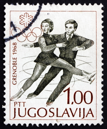 YUGOSLAVIA - CIRCA 1968: a stamp printed in the Yugoslavia shows Figure Skating Pair, Figure Skating, Pair, Winter Olympic sports, Grenoble 68, circa 1968