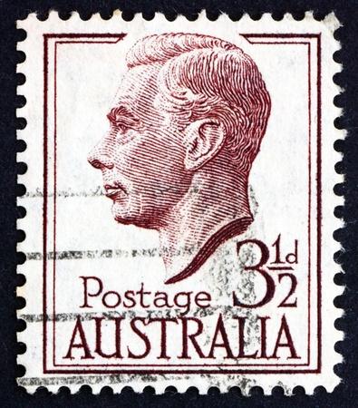 dominions: AUSTRALIA - CIRCA 1951: a stamp printed in the Australia shows George VI, King of the United Kingdom and the Dominions of the British Commonwealth, circa 1951 Editorial