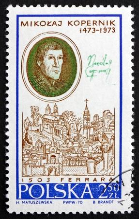 astronomer: POLAND - CIRCA 1970: a stamp printed in the Poland shows Nicolaus Copernicus, by Zinck Nora and View of Ferrara, Mathematician, Astronomer, circa 1970