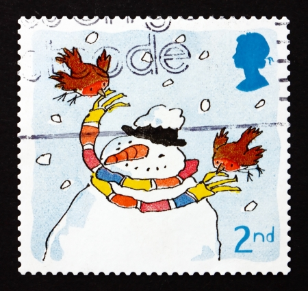 GREAT BRITAIN - CIRCA 2001: a stamp printed in the Great Britain shows Robins and Snowman, Christmas, circa 2001