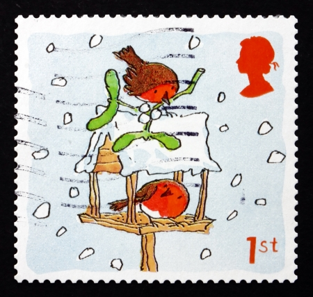 GREAT BRITAIN - CIRCA 2001: a stamp printed in the Great Britain shows Robins and Birdhouse, Christmas, circa 2001