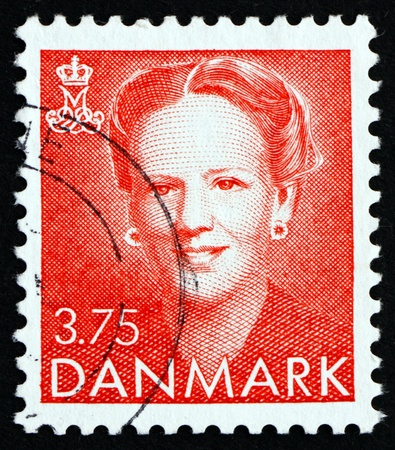 accession: DENMARK - CIRCA 1990: a stamp printed in the Denmark shows Queen Margrethe II, Queen of Denmark, 10th Anniversary of Accession, circa 1990 Editorial