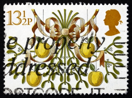 GREAT BRITAIN - CIRCA 1980: a stamp printed in the Great Britain shows Mistletoe and Apples, Christmas, circa 1980