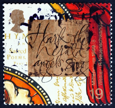 hymn: GREAT BRITAIN - CIRCA 1999: a stamp printed in the Great Britain shows John Wesley Founder of Methodism, and Hark, The Herald Angels Sing, Hymn by Brother Charles, circa 1999
