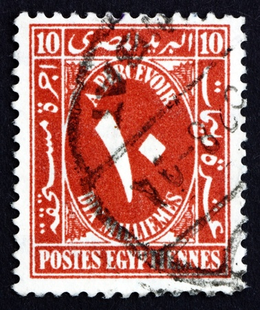 arabic numeral: EGYPT - CIRCA 1929: a stamp printed in Egypt shows Arabic Numeral, Ten, circa 1929 Editorial