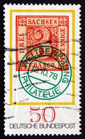 no movement: GERMANY - CIRCA 1978: a stamp printed in the Germany shows Saxony No. 1 Stamp with World Philatelic Movement Cancel, Stamp Day, circa 1978 Editorial