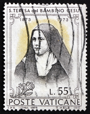 carmelite nun: VATICAN - CIRCA 1973: a stamp printed in the Vatican shows St. Teresa of Lisieux and of the Infant Jesus, Carmelite Nun, circa 1973