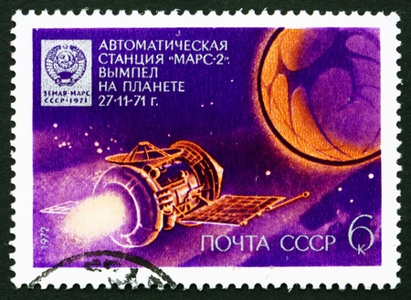 RUSSIA - CIRCA 1972: a stamp printed in the Russia shows Mars 2 Approaching Mars, and Emblem Dropped on Mars, Cosmonauts Day, circa 1972