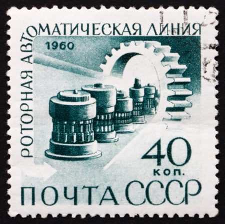 mechanization: RUSSIA - CIRCA 1960: a stamp printed in the Russia shows Automatic Production Line and Gear, Publicizing Mechanization and Automation of Factories, circa 1960