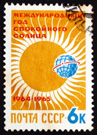 RUSSIA - CIRCA 1964: a stamp printed in the Russia shows Partial Eclipse of Sun, International Quiet Sun Year, circa 1964
