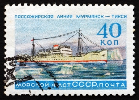honoring: RUSSIA - CIRCA 1959: a stamp printed in the Russia shows Ship, Murmansk – Tyksi Line, Honoring the Russian Fleet, circa 1959