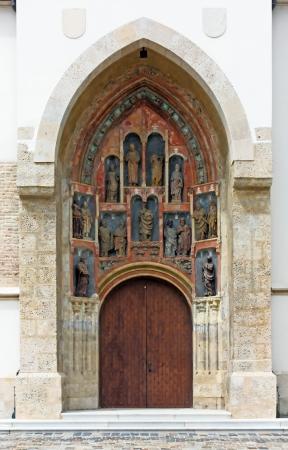 Entrance door to the Church of St. Mark, Zagreb, Croatia photo