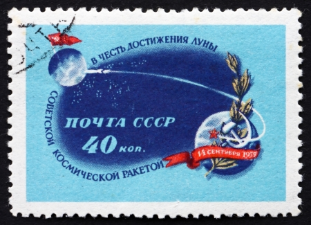 RUSSIA - CIRCA 1959: a stamp printed in the Russia shows Moon, Earth and Path of Rocket, Landing of the Soviet Rocket on the Moon, circa 1959 Stock Photo - 20345856