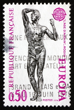 rodin: FRANCE - CIRCA 1974: a stamp printed in the France shows Age of Bronze, Sculpture by Auguste Rodin, circa 1973