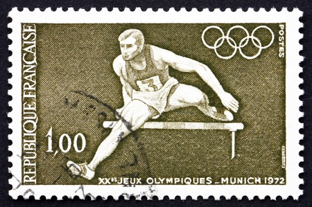 hurdling: FRANCE - CIRCA 1972: a stamp printed in the France shows Hurdler and Olympic Rings, 20th Olympic Games, Munich, Germany, circa 1972