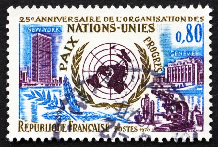 un used: FRANCE - CIRCA 1970: a stamp printed in the France shows UN Headquarters in New York and Geneva, 25th Anniversary of the United Nations, circa 1970