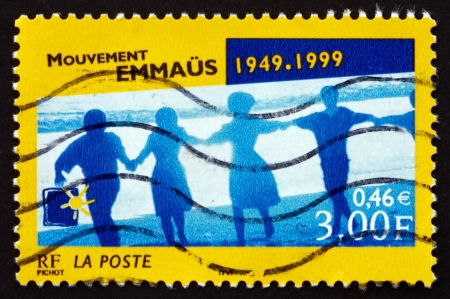 founded: FRANCE - CIRCA 1999: a stamp printed in the France shows Emmaus Movement, 50th Anniversary, International Charitable Movement Founded in Paris in 1949, circa 1999 Editorial