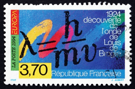 developed: FRANCE - CIRCA 1994: a stamp printed in the France shows Formula for Wave Properties of Matter, Developed by Louis de Broglie, circa 1994