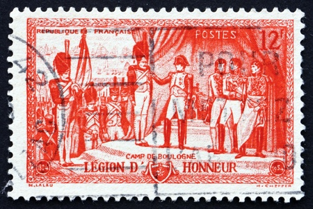 FRANCE - CIRCA 1954: a stamp printed in the France shows Napoleon Awarding Legion of Honor Decoration, 150th Anniversary of the 1st Legion of Honor Awards at Camp de Boulogne, circa 1954