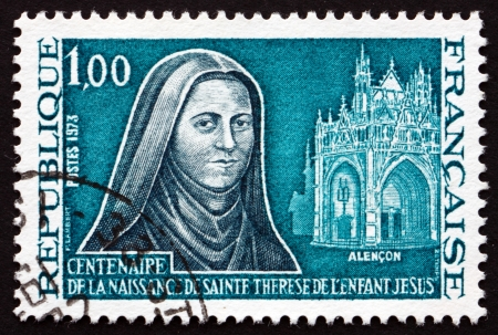 carmelite nun: FRANCE - CIRCA 1973: a stamp printed in the France shows St. Teresa of Lisieux and Portal of Notre Dame of Alencon, circa 1973