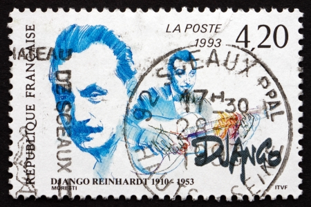 virtuoso: FRANCE - CIRCA 1993: a stamp printed in the France shows Jean Django Reinhardt, Musician, Pioneering Virtuoso Jazz Guitarist and Composer, circa 1993