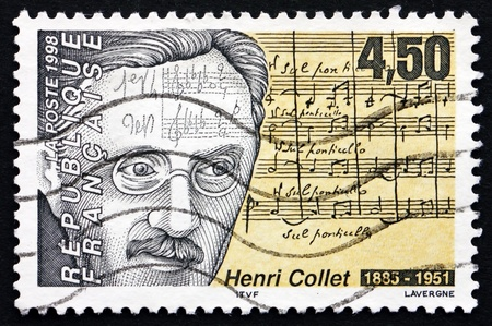 critic: FRANCE - CIRCA 1998: a stamp printed in the France shows Henri Collet, French Composer and Music Critic, circa 1998 Editorial