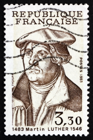 reformation: FRANCE - CIRCA 1983: a stamp printed in the France shows Martin Luther German Priest, who initiated the Protestant reformation, circa 1983