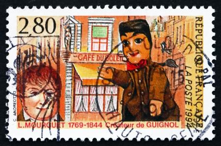 creador: FRANCIA - CIRCA 1994: un sello impreso en la Francia muestra Laurent Mourguet, creador de marionetas Guignol, alrededor de 1994