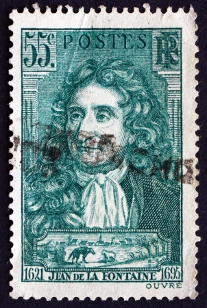 fontaine: FRANCE - CIRCA 1938: a stamp printed in the France shows Jean de La Fontaine, Fabulist and Poet, circa 1938
