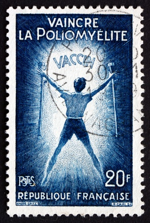 polio: FRANCE - CIRCA 1959: a stamp printed in the France shows Polio Victim Holding Crutches, Vaccination against Poliomyelitis, circa 1959