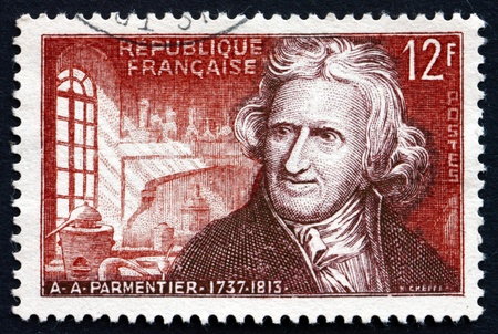 popularized: FRANCE - CIRCA 1956: a stamp printed in the France shows Antoine Augustin Permentier, Nutrition Chemist, who Popularized the Potato in France, circa 1956 Editorial