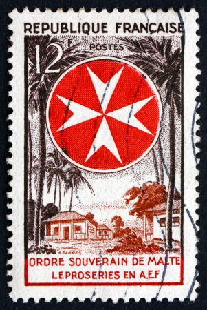 FRANCE - CIRCA 1956: a stamp printed in the France shows Leprosarium and Maltese Cross, Knights of Malta, circa 1956