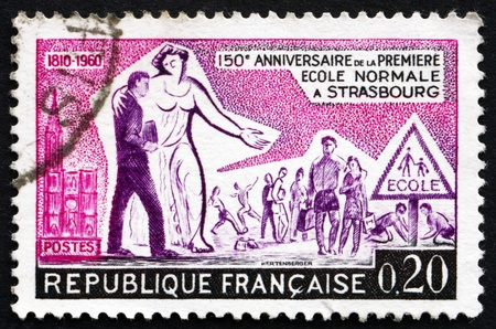 post secondary schools: FRANCE - CIRCA 1960: a stamp printed in the France shows Education and Children, 150th Anniversary of 1st Secondary School in Strasbourg, circa 1960