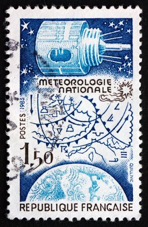FRANCE - CIRCA 1983: a stamp printed in the France shows National Weather Forecasting, Satellite, Map and Globe, circa 1983