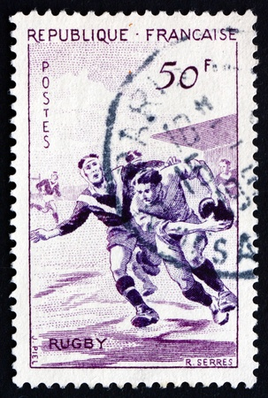 FRANCE - CIRCA 1956: a stamp printed in the France shows Rugby, Team Sport, circa 1956