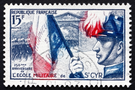 founding: FRANCE - CIRCA 1954: a stamp printed in the France shows Cadets Marching Through Gateway, 150th Anniversary of the Founding of the Military School of Saint-Cyr, circa 1954