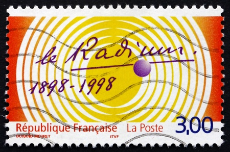 FRANCE - CIRCA 1998: a stamp printed in the France shows Centenary of Discovery of Radium, ZOE Reactor, 50th Anniversary, circa 1998