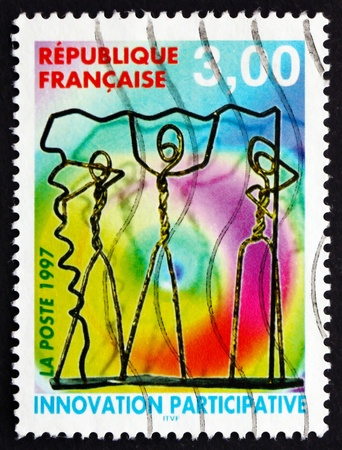 participatory: FRANCE - CIRCA 1997: a stamp printed in the France shows Participatory Inovation, Wire Characters, circa 1997