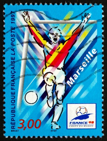 FRANCE - CIRCA 1997: a stamp printed in the France shows Marseilles, Host City of 1998 World Cup Soccer Championships, Stylized Action Scene, circa 1997