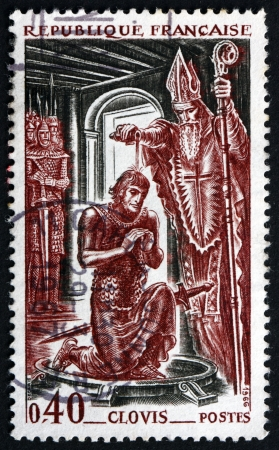 baptizing: FRANCE - CIRCA 1966: a stamp printed in the France shows Bishop Remi Baptizing King Clovis, King of the Franks, 496 A.D., circa 1966