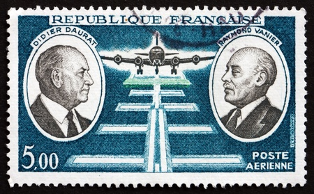 pioneers: FRANCE - CIRCA 1971: a stamp printed in the France shows Didier Daurat and Raymond Vanier, Aviation Pioneers, Plane Landing at Night, circa 1971 Editorial