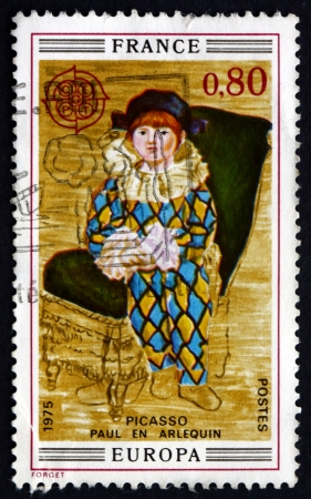 pablo picasso: FRANCE - CIRCA 1975: a stamp printed in the France shows Paul as Harlequin, Painting by Pablo Picasso, Portrait, circa 1975 Editorial