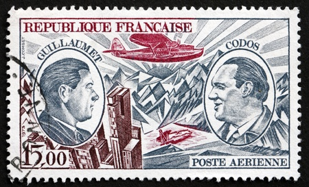 pioneers: FRANCE - CIRCA 1973: a stamp printed in the France shows Henri Guillaumet and Paul Codos, Aviation Pioneers, Guillaumet�s Crashed Plane in Andes, circa 1973