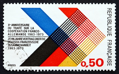 FRANCE - CIRCA 1973: a stamp printed in the France shows Colors of France and Germany Interlaced, 10th Anniversary of the Franco-German Cooperation Treaty, circa 1973