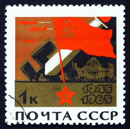 soviet flag: RUSSIA - CIRCA 1965: a stamp printed in the Russia shows Soviet Flag, Broken Swastikas, Fighting in Berlin, War of Liberation, 1941 � 1945, circa 1965