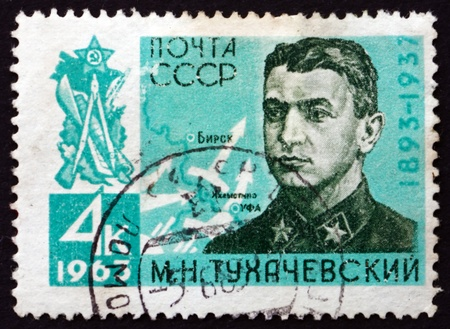 mikhail: RUSSIA - CIRCA 1963: a stamp printed in the Russia shows General Mikhail Nikolayevich Tukhachevsky, Marshal of the Soviet Union, circa 1963 Editorial