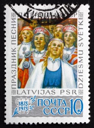 centenary: RUSSIA - CIRCA 1973: a stamp printed in the Russia shows Latvian Song Festival, Centenary, circa 1973 Editorial
