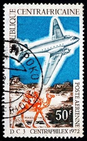 camel post: CENTRAL AFRICAN REPUBLIC - CIRCA 1972: a stamp printed in Central African Republic shows DC-3 and Mailman Riding Camel, circa 1972