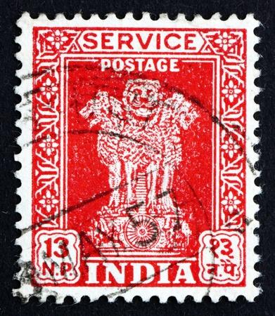 sarnath: INDIA - CIRCA 1957: a stamp printed in India shows Lion Capital of Ashoka Pillar from Sarnath, National Emblem of India, circa 1957 Editorial